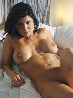 Huge titted mature brunette using a massive dildo 8